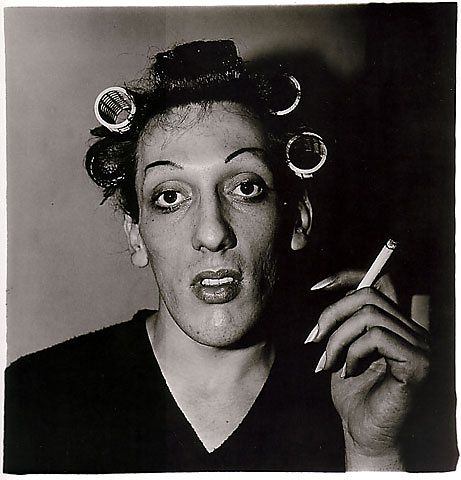 A young man with curlers at home on West 20th Street, 1966 © Diane Arbus