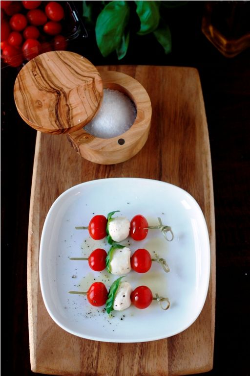 Caprice Kabobs  Cherry tomatoes  bocconcini {small fresh mozzarella balls}  basil  extra virgin olive oil  salt/pepper
