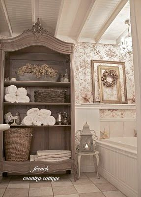 Baker French Country Cottage's bathroom is incredibly charming. Lots of before and after pics!