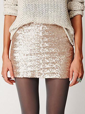 Chunky knit sweater, glitter mini skirt, & black tights.