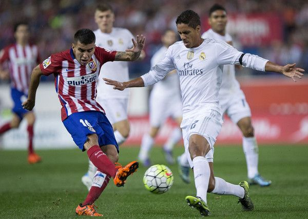 Raphael Varane Photos Photos - Angel Martin Correa (L) of Atletico de Madrid competes for the ball with Raphael Varane (R) of Real Madrid CF during the La Liga match between Club Atletico de Madrid and Real Madrid CF at Vicente Calderon Stadium on October 4, 2015 in Madrid, Spain. - Club Atletico de Madrid v Real Madrid CF - La Liga