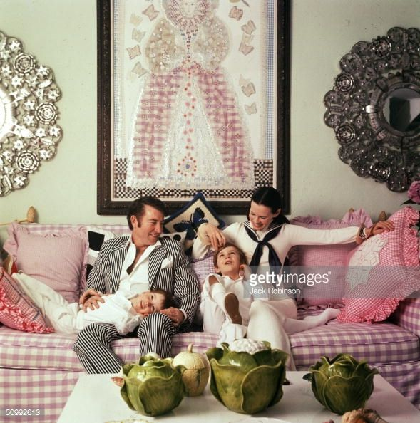 Family portrait of the Coopers as they play on a sofa in their home, Southampton, Long Island, New York, March 30, 1972. American author and actor Wyatt Emory Cooper and heiress Gloria Vanderbilt Cooper sit with their sons, Carter (1965 - 1988) and Anderson Cooper.