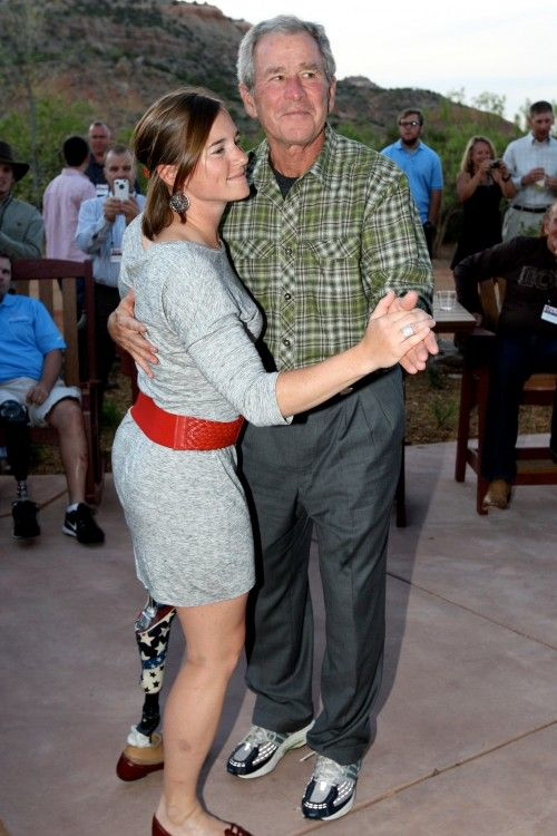 So sweet: President Bush dancing with the first female soldier to lose a limb in combat.  Heroism.
