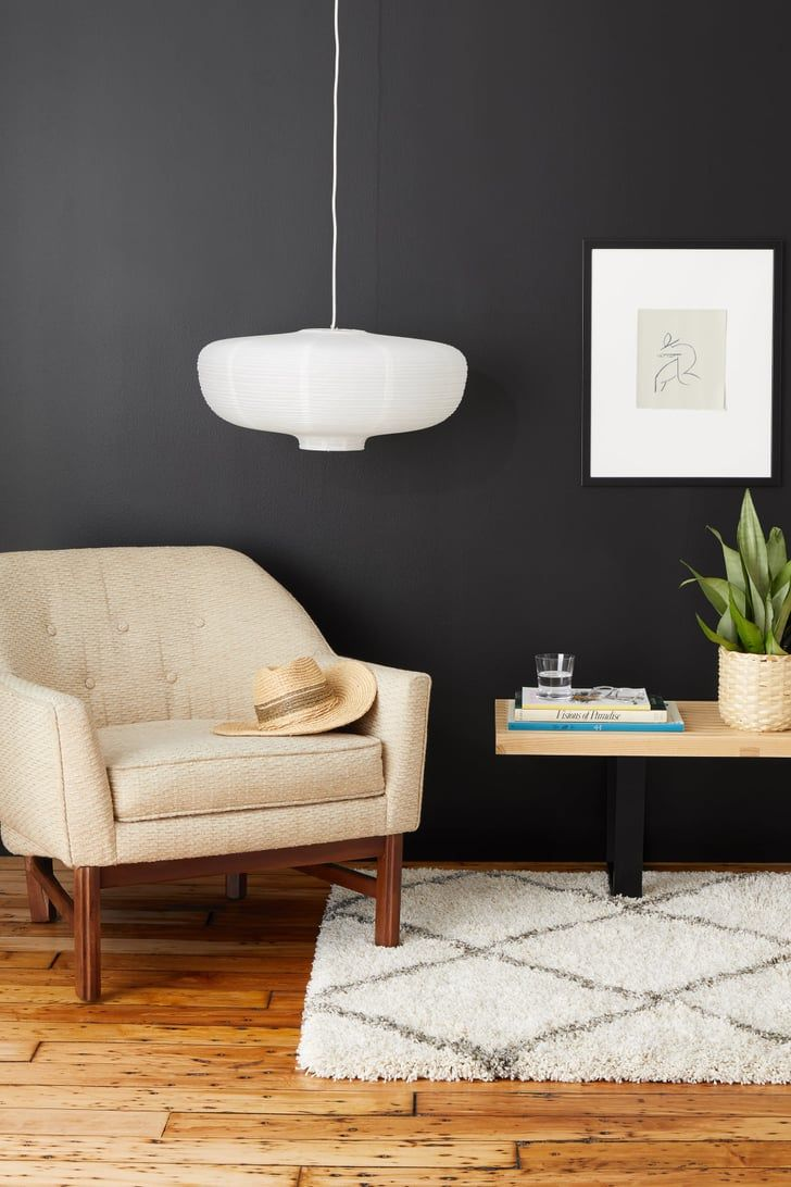 How To Pull Off A Matte Black Accent Wall While Keeping Your Space Nice And Bright Black Accent Wall Living Room Black Accent Walls Accent Walls In Living Room