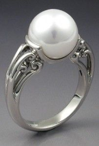 Pearl and silver rings are beautiful!  although this band is ugly