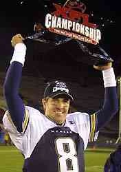 The Million Dollar Game  Los Angeles Xtreme quarterback Tommy Maddox holds the championship trophy after their 38-6 victory Saturday over the San Francisco Demons in the XFL championship game at the Los Angeles Coliseum. (Allsport)
