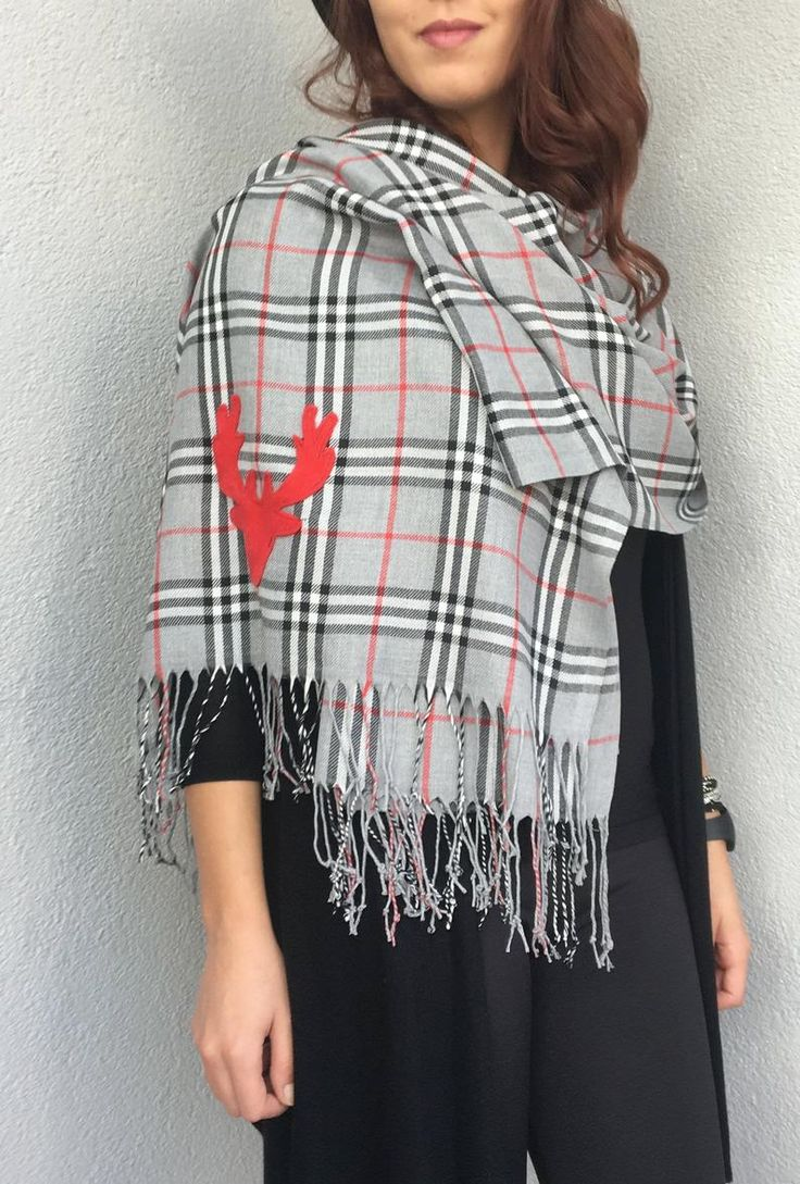 This unique pashmina scarf is in gray and red plaid pattern. There is red deer d…