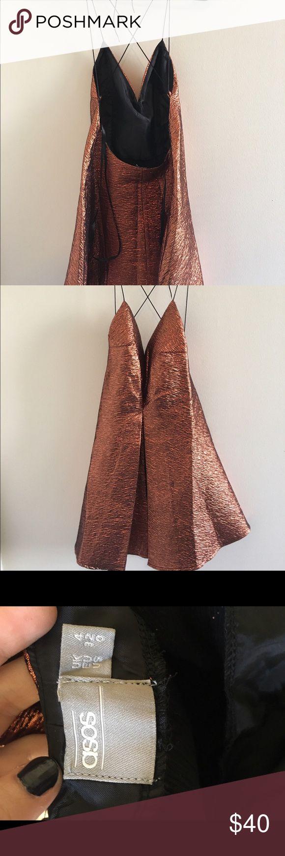 Bronze mini dress Bronze metallic mini dress. Never worn from asos size 0 ASOS Dresses Mini