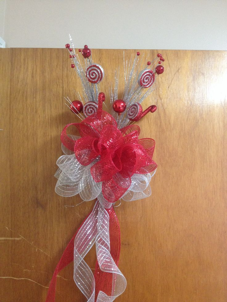 Deco mesh ribbon bow tree topper. Material bought from