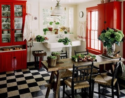 kitchen: b/w floor tiles, red accents.  Let me know if you know where this photo is from.