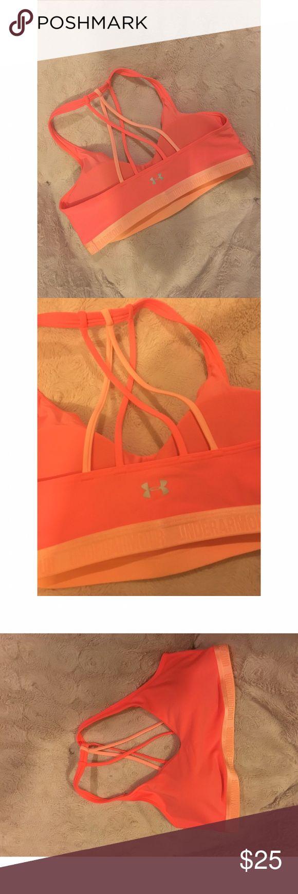 NWOT under Armour sports bra size L Large under Armour orange sports bra. Never tried on never worn. Open racer back. Under Armour Intimates & Sleepwear Bras