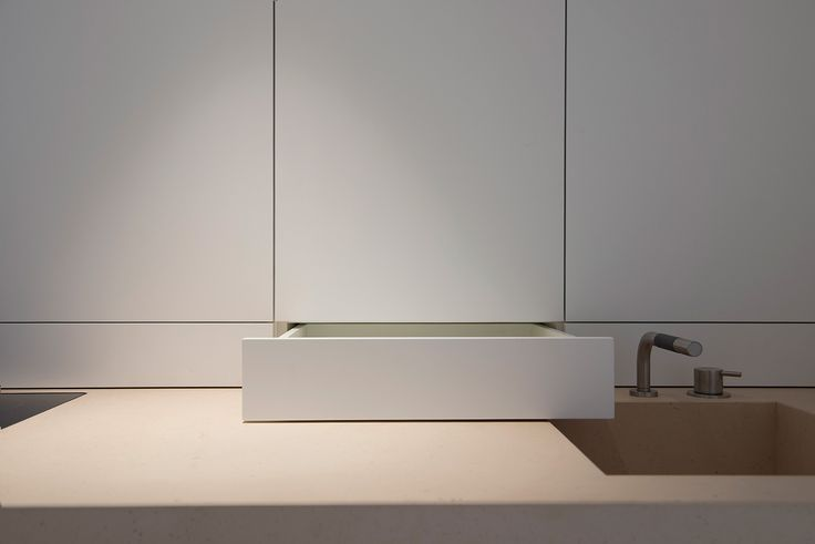 Koetsier - Van der Velden studio •     Pantry executed by Nieuwkoop International. Bespoke interior design. Modern interior. Interior details. White lacquer. Minimalism. Limestone worktop with integrated limestone washbasin.