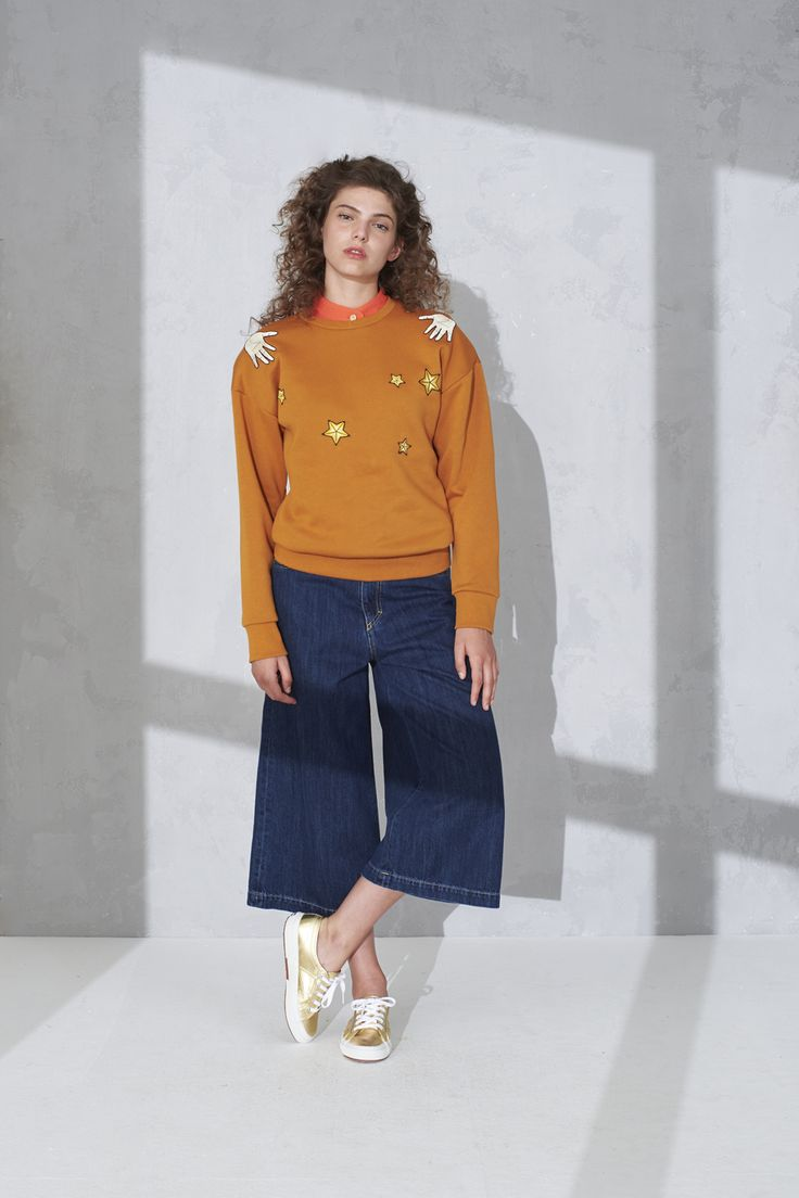 Drop shoulder sweater with badge detail, eco washed cropped jeans and sleeveless crop shirt