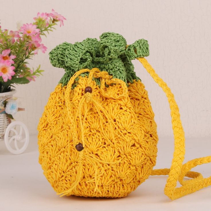 Pineapple bag!!! Make beanie shape for bottom and don't spread out stitches. Spread stitches for leaves by a lot. Thread strand for tie. Like Angela :) Can crochet small balls at end of tie. Panda version wouldn't be bad