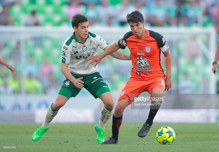 Erick Gutierrez of Pachuca and Ulises Rivas of Santos fight for the ball during the 13th round match between Santos Laguna and Pachuca as part of the Torneo Clausura 2017 Liga MX at Corona Stadium on April 09, 2017 in Torreon, Mexico.
