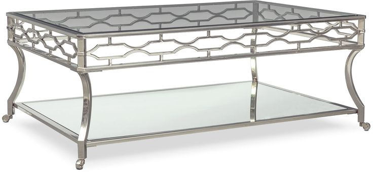Beautifully Defined. The dazzling Galleria cocktail table is the perfect combination of glam and art deco allure. Featuring a polished chrome frame, this piece is adorned in a mesmerizing pattern with stylish curves. This table includes two tempered glass shelves for displaying décor or storing magazines and books, increasing functionality.