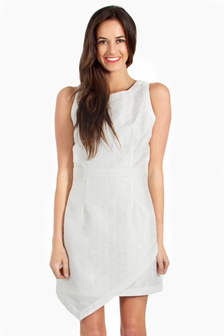 Look white hot in this brocade dress with an asymmetrical hem. Features an exposed zipper closure on back. Pair this with a statement necklace and nude strappy heels for a nice dinner date. 50% Cotton, 35% Polyester, 15% Nylon $37