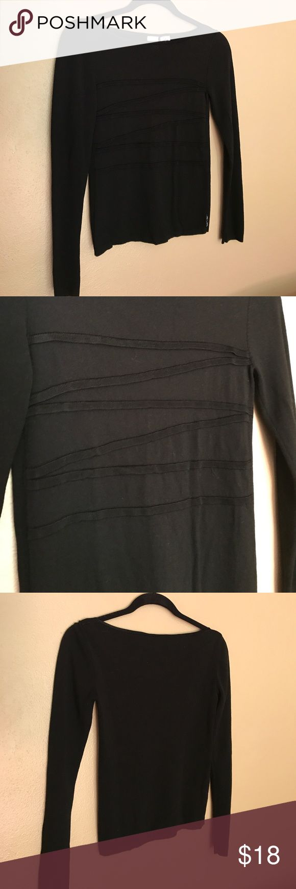 "ARMANI EXCHANGE TOP ARMANI EXCHANGE TOP. 14 1/2"" from under arm to under arm. 20 1/2"" from shoulder to bottom hem. 13 1/2"" across hem. 87% Rayon, 13% Polyester. Excellent Condition A/X Armani Exchange Tops"