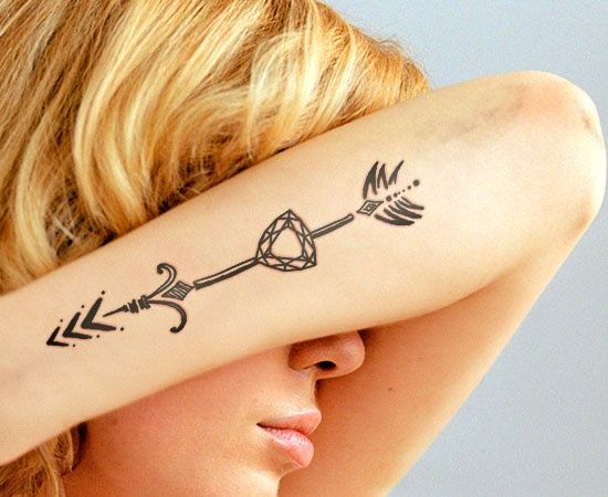 Woman with Arm Arrow through Diamond Tattoo