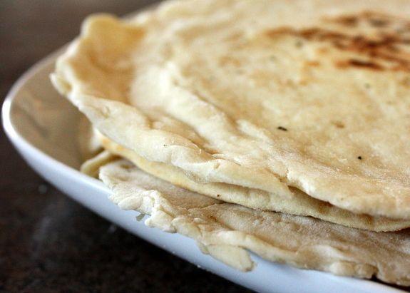 Cafe Rio home made tortillas - 2 cups white flour 1 1/2 tsp baking powder 1 tsp salt 2 tsp vegetable oil 3/4 c warm water Mix dry, mix wet, slowly combine. Knead & divide. Let sit 20 minutes. Knead. Let sit 10 minutes. Cook.