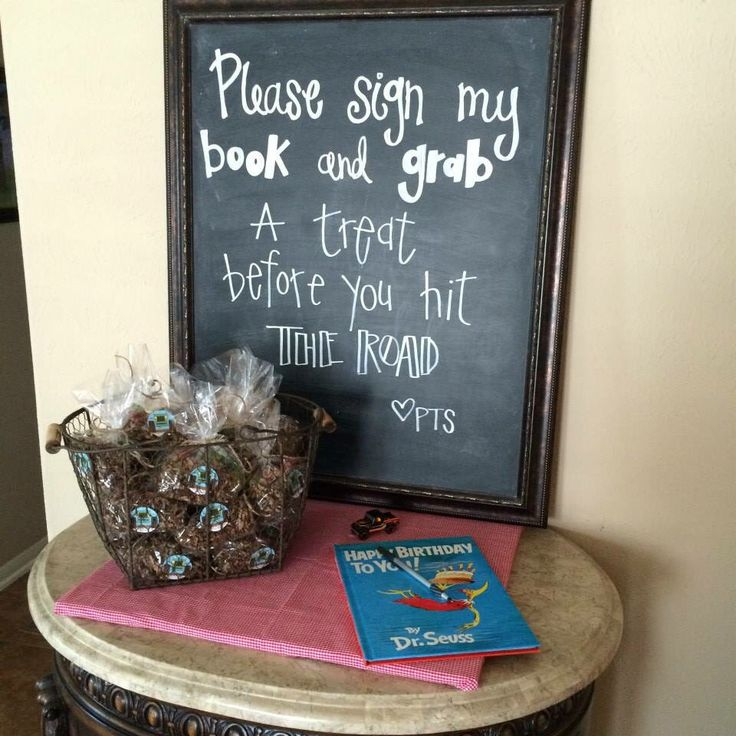 Picture frame turned chalkboard  Dr. Seuss is my go-to book for a good guest book. Brings back memories every time it's opened to be read!  Party favors - brown krinkle paper, Jeep hot wheels, and gummy worms