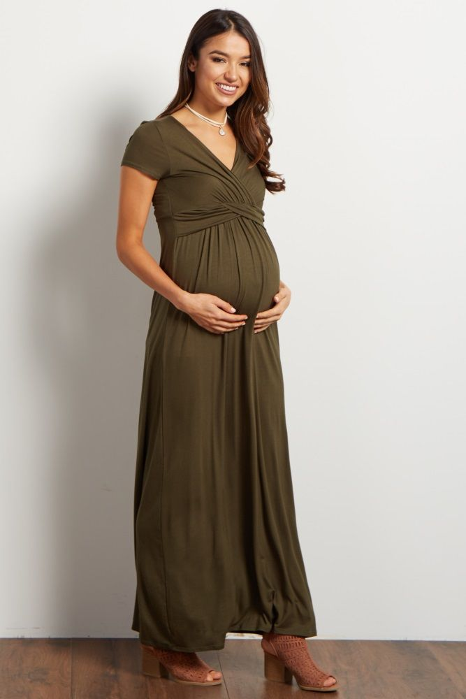 Transition with effortless style in this solid draped maternity maxi dress. A gorgeous draped front and cinched style offer you a flattering look from pregnancy to motherhood.