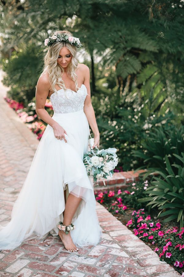 Caitlin and Matt's Garden California Wedding by Kambria Fischer Photography | No shoes for this gorgeous bride! Pink rose anklets were worn by this barefoot bride to match her pink rose floral crown and white wedding bouquet, all the perfect complements to her sparkly strapless wedding dress.