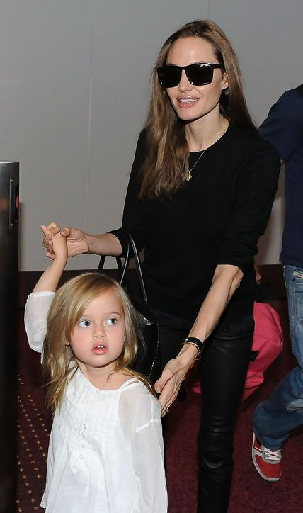 Is Angelina Jolie Into Mom Jeans for Travel With the Kids? - luv to have one of these Denim-waxed jeans.