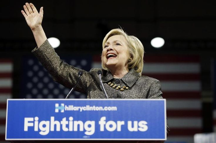 """Hillary Clinton's placard slogan """"Fighting for us'' is just one of several she has used."""