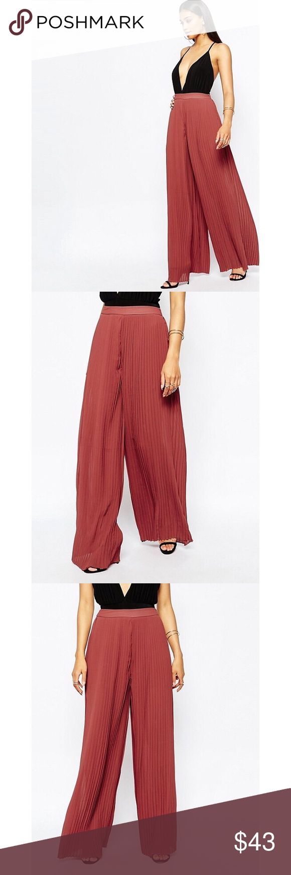 Black Missguided Pleated Wide Leg Trousers THIS LISTING IS FOR BLACK PANTS These wide leg pants are a must have in every girls wardrobe this season. We're loving these pleated pants with a small zip which is disguised at the side. Wear with a body suit and some strappy heels for a super chic evening look.  Materials: Polyester *Lined with same color shorts & stay sheer throughout the floor sweeping wide leg silhouette  Tag was removed from pants as seen in last photo; Original manufacturer…