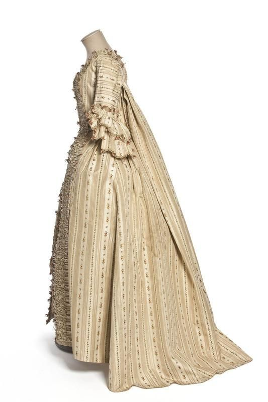 Side view, robe à la française, France 1775-1780. Ivory and champagne striped silk with floral motifs.