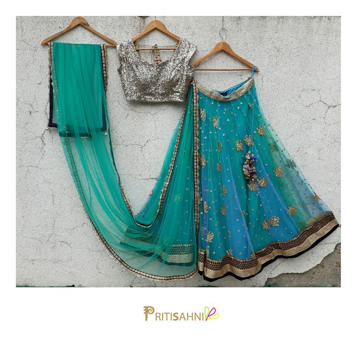 Play of colors.Look gorgeous in this lovely lehenga set on your Sangeet and Mehendi day . Beautiful powder blue lehenga and silver blouse from Pritisahni.For more information write to info@pritisahni.com . 02 July 2017