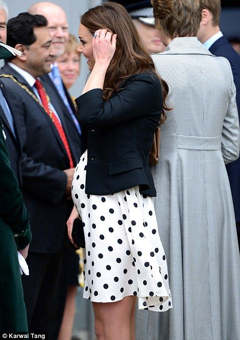 Pregnant Duchess looks magic in a £38 polka-dot High Street dress as Royals escort group of children to the Harry Potter film studios  Read more: http://www.dailymail.co.uk/femail/article-2315136/Kate-Middleton-pregnant-Duchess-Cambridge-wears-Topshop-dress-joins-Princes-tour-Harry-Potter-film-studios.html#ixzz2RaGuqGBP  Follow us: @MailOnline on Twitter | DailyMail on Facebook