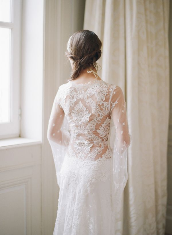 Illusion lace wedding dress with bell sleeves: http://www.stylemepretty.com/collection/2115/ Photography: Sylvie Gil - http://www.sylviegilphotography.com/