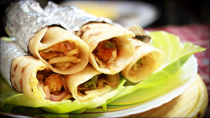 """Chicken roll is one of the popular street-food originated fromKolkata. That's why it is often called the """"Calcutta Roll"""". This is a roll where Juicy morsels of spicy chicken are wrapped in Paratha that has been coated with egg! So it has two basic parts. One is making paratha and another is inner chicken stuffing. […]"""