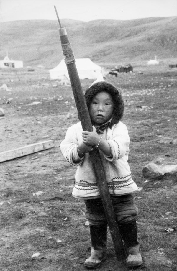 framingcanada: Inuit child with harpoon, Sugluk, Quebec, 8 Sept. 1958. (via Archives Search - Library and Archives Canada) Credit: Charles Gimpel / Library and Archives Canada