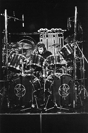 "Black and white pin portrait via William Cleff with note: ""I saw Neil Peart play this kit in 1978 and 1979.  Fantastic drummer!"" - From DdO:) - http://www.pinterest.com/DianaDeeOsborne/drums-drumming-joy - Peart, a Canadian musician and author, is drummer  lyricist for the rock band Rush. He's received numerous awards for music and is recognized for stamina during lengthy concerts with technical proficiency in drumming."