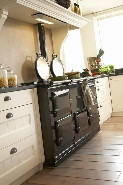 Kitchen with Aga and light hidden in the overmantle - ONE DAY I'LL HAVE ONE LOL