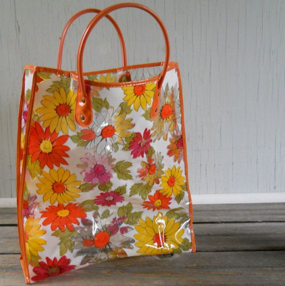 In the 70's - I had a plastic clear flowered orange daisy tote just like this! Swung and wacked it about, went through one yearly as a wee destructive lassie.