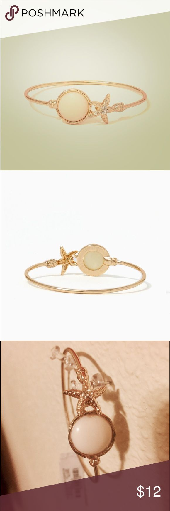 """NWT Charming Charlie Bracelet NWT Charming Charlie gold """"cape cod"""" inspired style bracelet. Gorgeous layering piece, gold starfish and a ivory/cream colored stone. Perfect/new condition! Charming Charlie Jewelry Bracelets"""