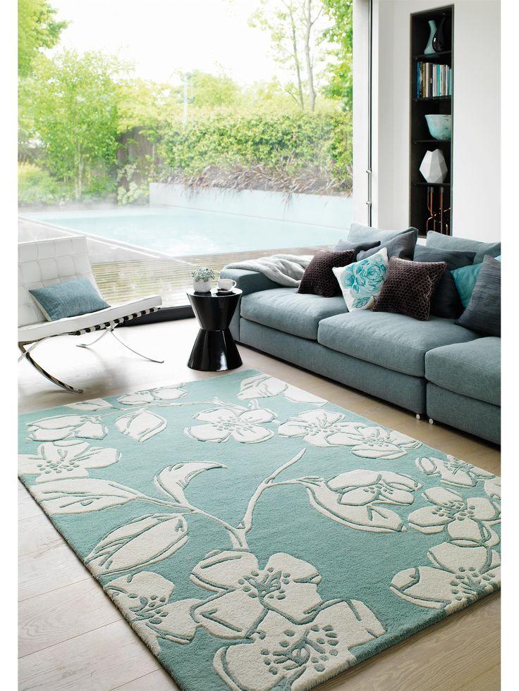 http://www.benuta.de/moderne-teppiche/kurzflor-teppiche/teppich-matrix-devore-blau.html Zarte Blütenpracht auf mintgrünem Hintergrund | benuta Teppich Matrix devore
