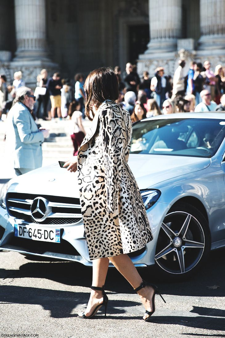 Lovely coat and a lovely car.