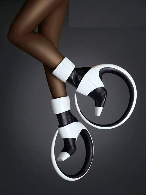Forget the unicycle roll up circus fashion fans, put down that spinning hoop and get some of these Avant garde geometric hoop boots to try and master instead, eclectic fun and great style for a performance outfit or street circus costume