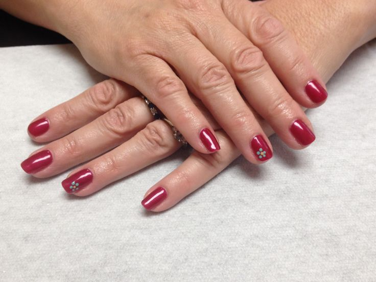 Red shimmer with teal daisy on accent nails Oasis Salon and Spa Mill ...
