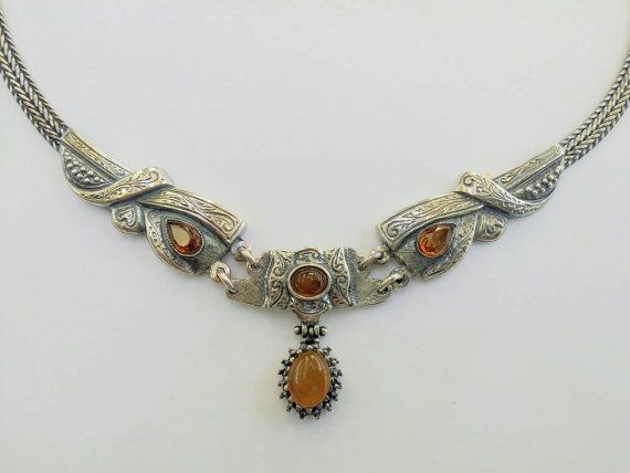 Check out this item in my Etsy shop https://www.etsy.com/uk/listing/505836573/amber-necklace-set-in-antique-silver
