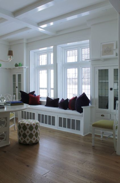Vandal and Ouellette brightened up the dining room by lacquering the original built-ins in a bright white.