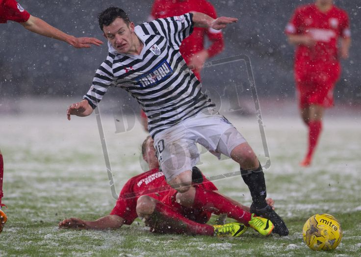 Queen's Park's David Galt being tackled during the SPFL League Two game between Queen's Park and Montrose.