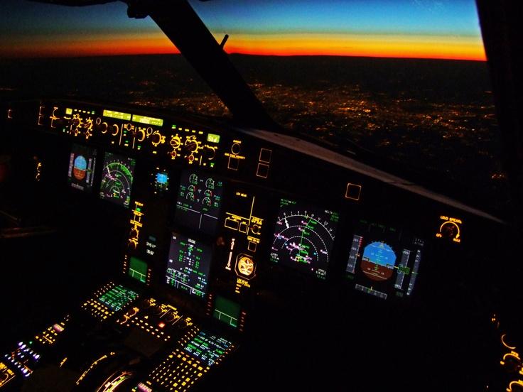 Glass cockpit SWISS A330-300 Flightdeck over Paris