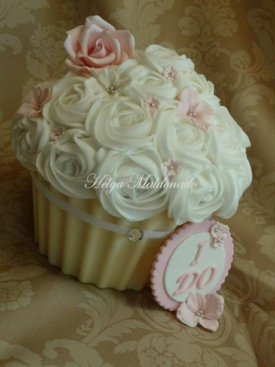 Giant cupcake wedding cake by shauna. I tried this one but  should have used the wilton tin.