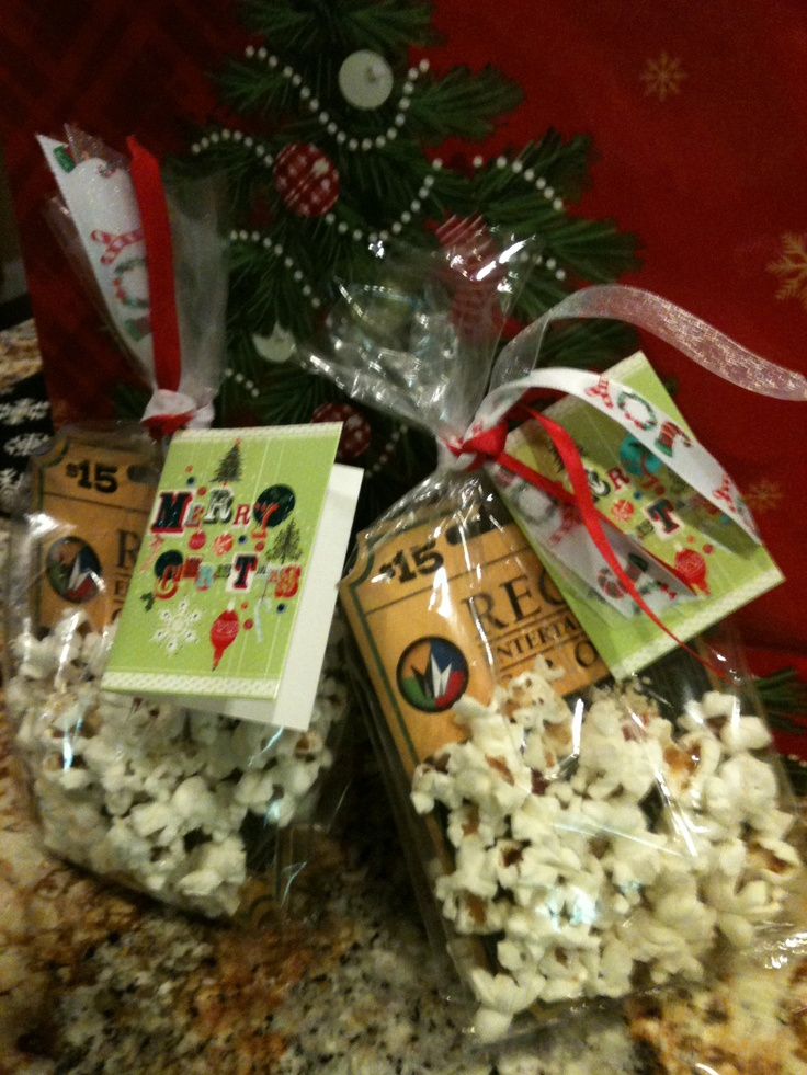 """Sprinkle in a little popcorn for bag """"stuffing"""" when giving movie ticket gift cards, finish off with cute red & white ribbon! :)"""